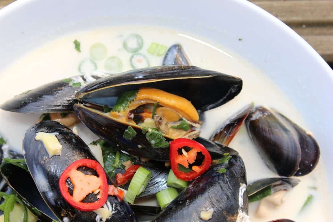 Thai mussels garnished with fresh chili
