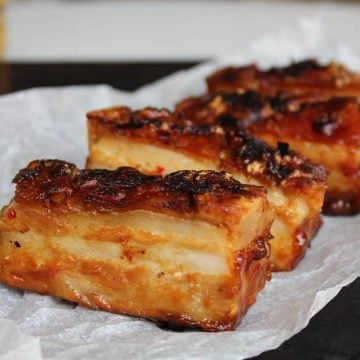 A side view of crispy pork belly slices