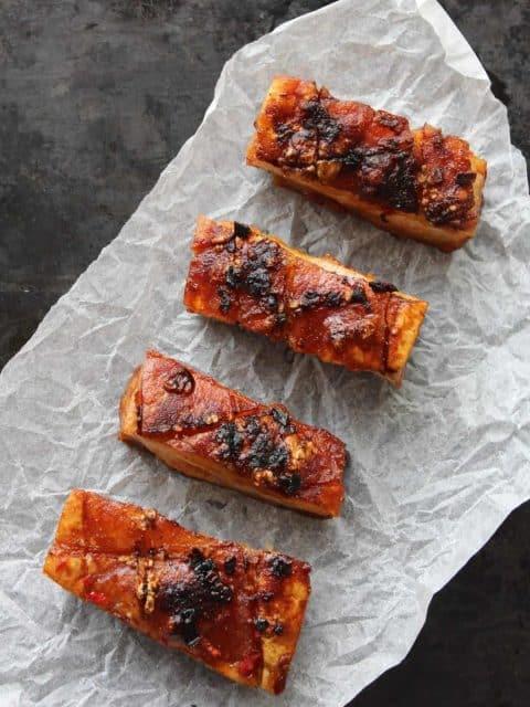 Chilli and Cider Pork Belly slices on a black background