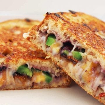 My Hot Berry Blueberry Grilled Cheese is quick and easy to make and super indulgent! Packed with cheese, jalapeno, blueberry and bacon. You can't get a better grilled cheese!! Grilled Cheese| Blueberry Grilled Cheese | Easy Grilled Cheese | Grilled Cheese with Bacon | Bacon and Blueberry | Spicy Grilled Cheese #grilledcheese #grilledcheesesandwich #blueberrygrilledcheese