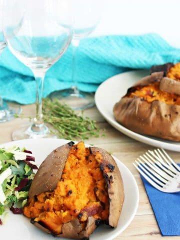 Twice baked stuffed sweet potatoes on a plate with salad