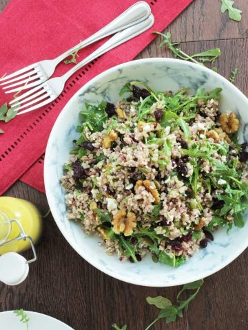 Top down shot of brown rice salad in a large serving bowl
