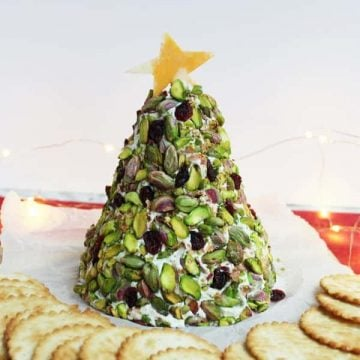 A Christmas tree cheese ball with crackers