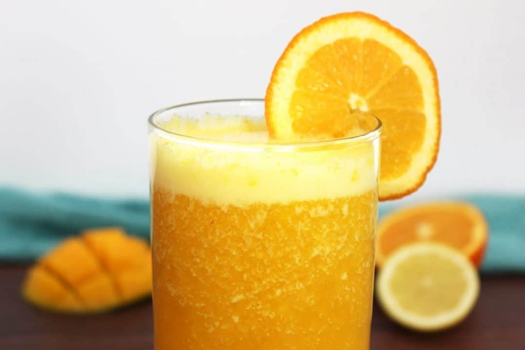 Close up of an anti inflammatory smoothie with orange garnish