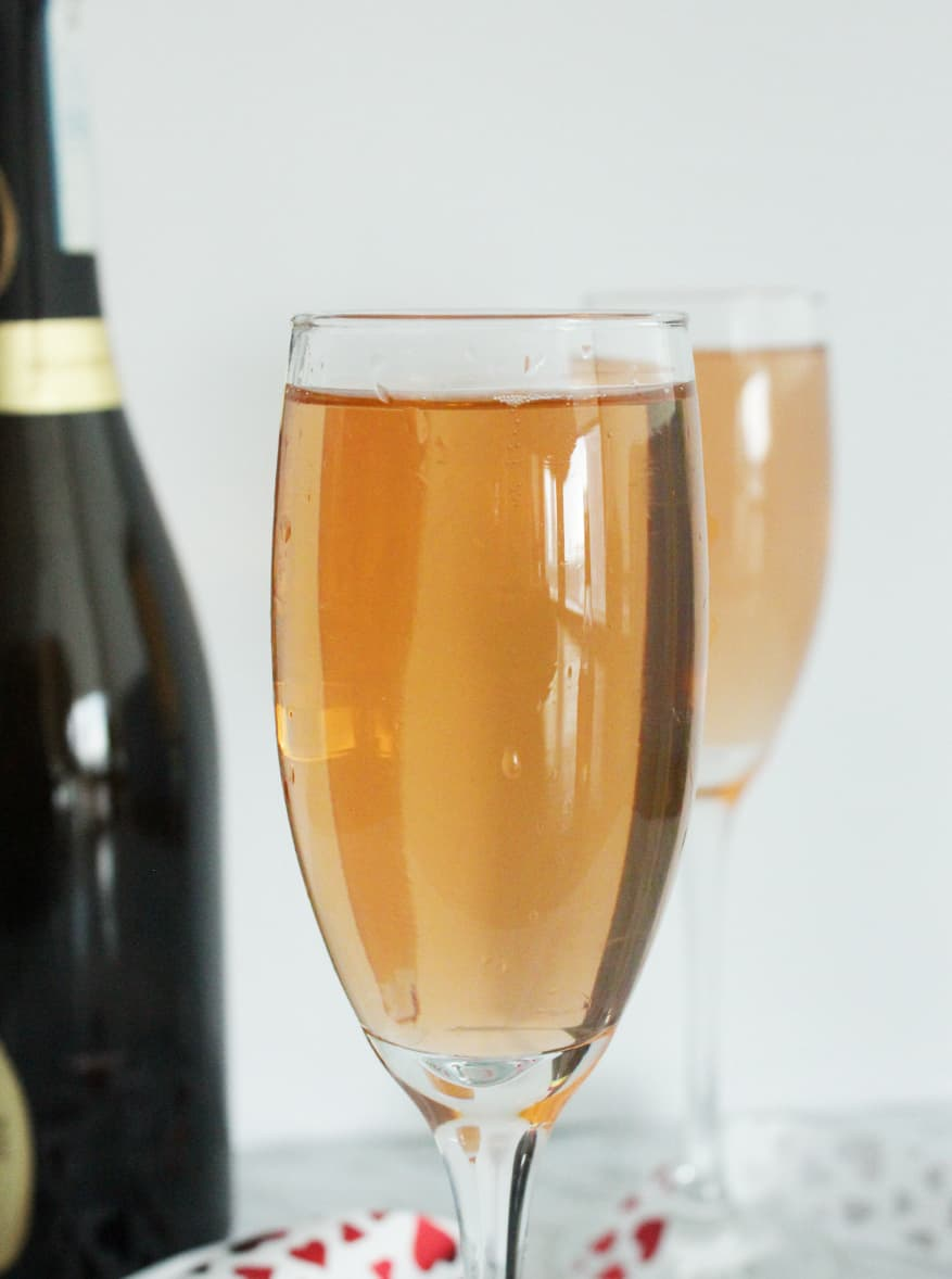 Close up of a prosecco cocktail on a white background
