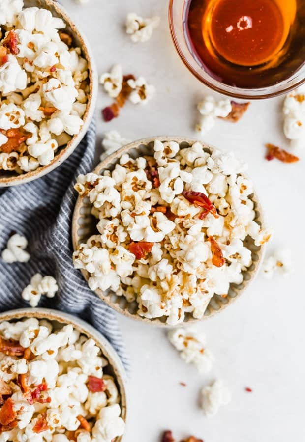 Top down shot of bowls of maple bacon popcorn
