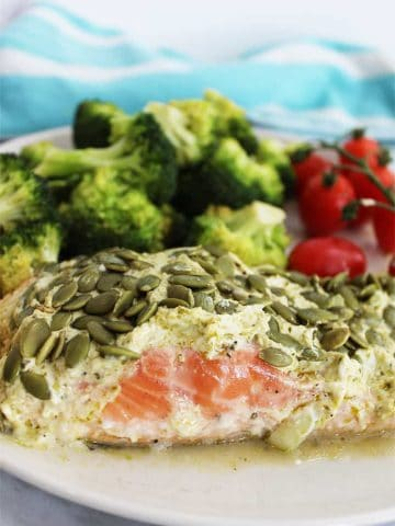 Close up of Salmon Baked in Foil on a white plate