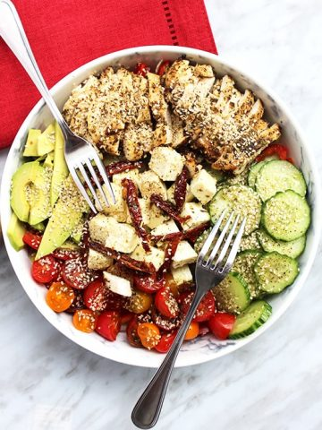 Top down shot of chicken salad in a white bowl
