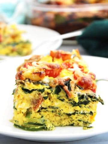 Side view of a layered sausage egg bake.