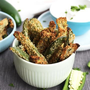 Close up of crispy jalapeno fries stacked in a tall bowl
