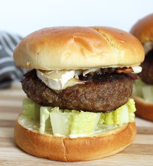 Close up of a honey and truffle burger with brie