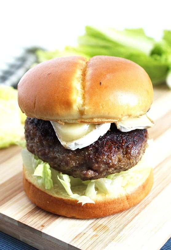 A honey and truffle burger on a chopping board
