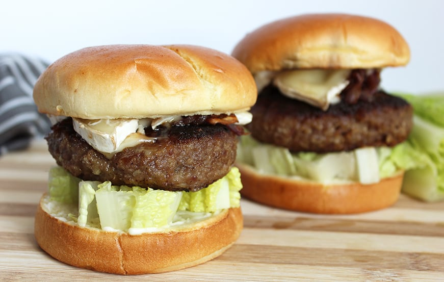 Two honey and truffle burgers topped with brie