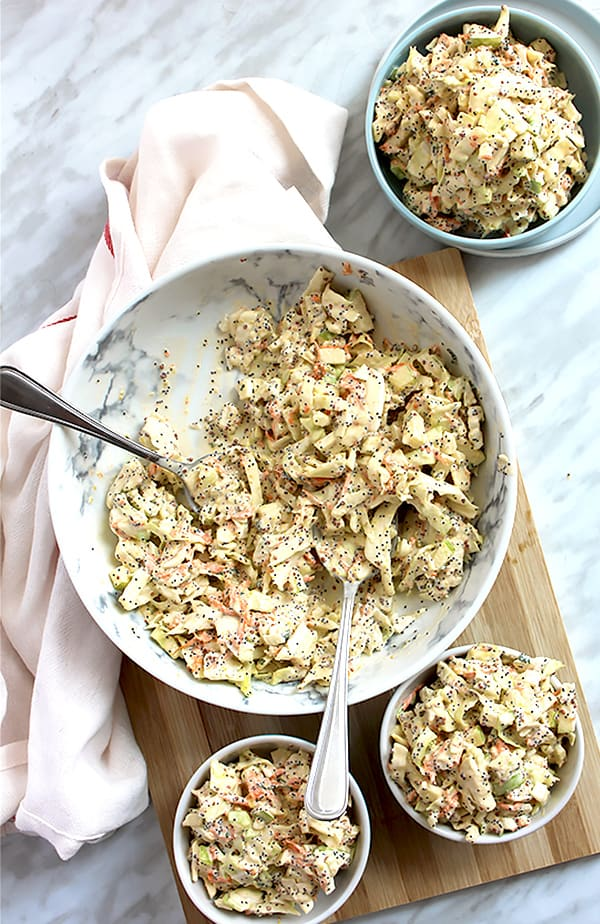 Top down shot of fennel apple coleslaw in different sized bowls