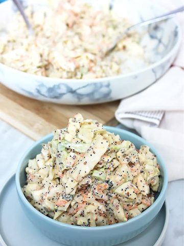 Fennel apple coleslaw in a small blue bowl