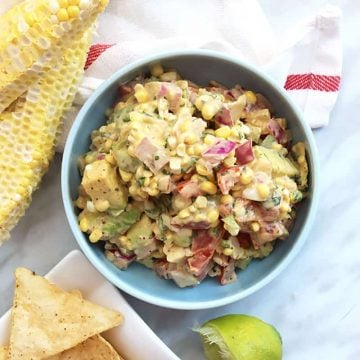 Close up of corn salsa with avocado in a blue dish