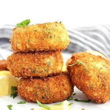 Three crab cakes stacked on top of eachother