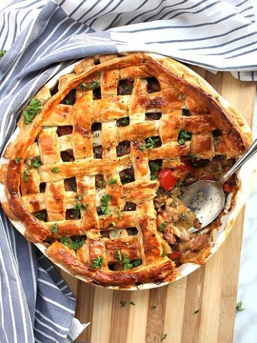 The baked pie on a wooden chopping board