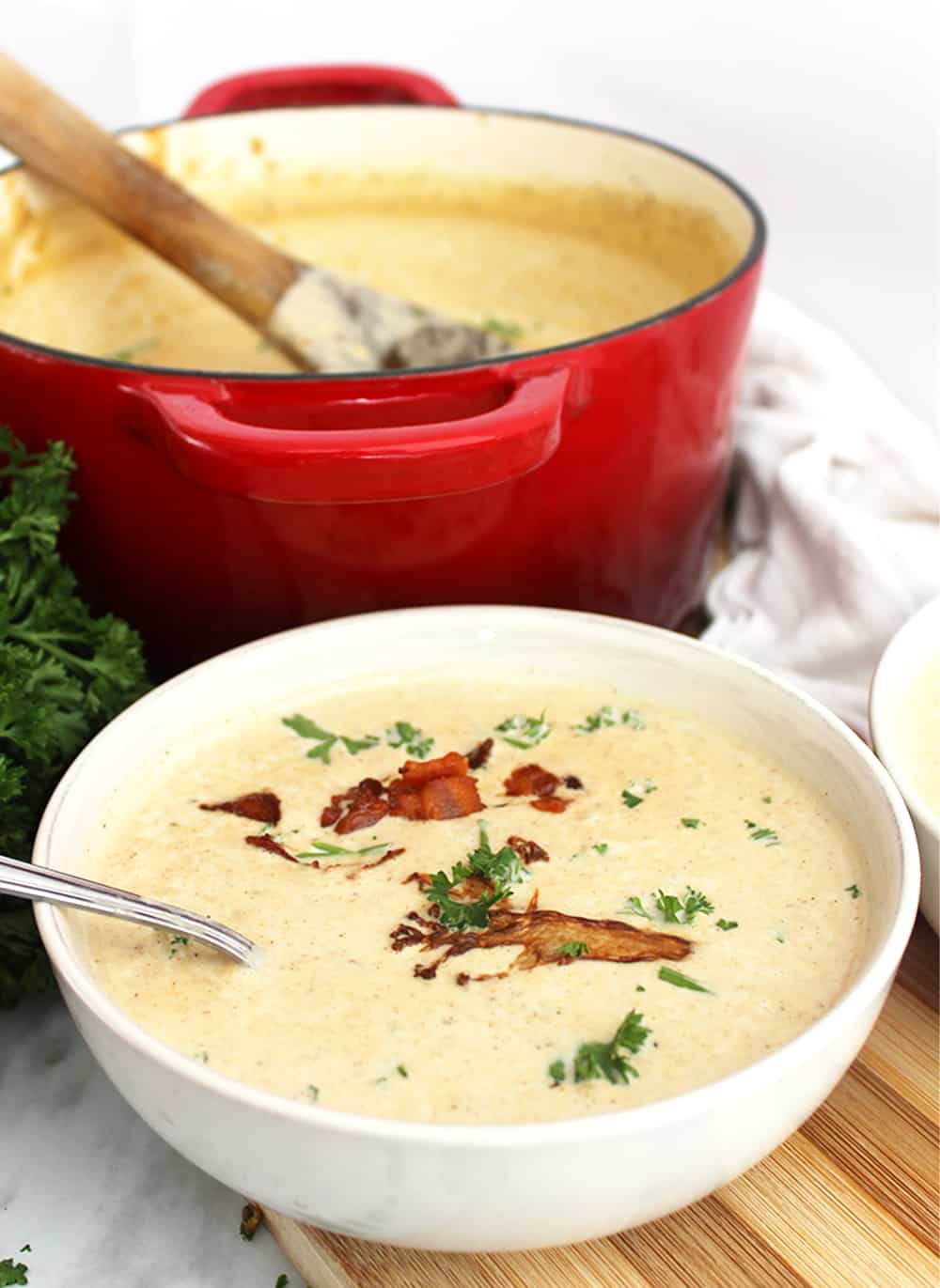 Cauliflower soup with fresh herbs and bacon