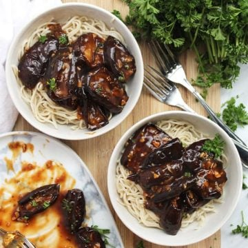 Baby eggplant with noodles in two white bowls