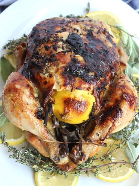 Slow roasted chicken stuffed with a lemon