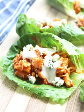 Lettuce wraps topped with chicken, blue cheese and ranch dressing