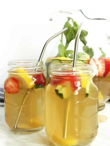 Two mason jar glasses with iced green tea