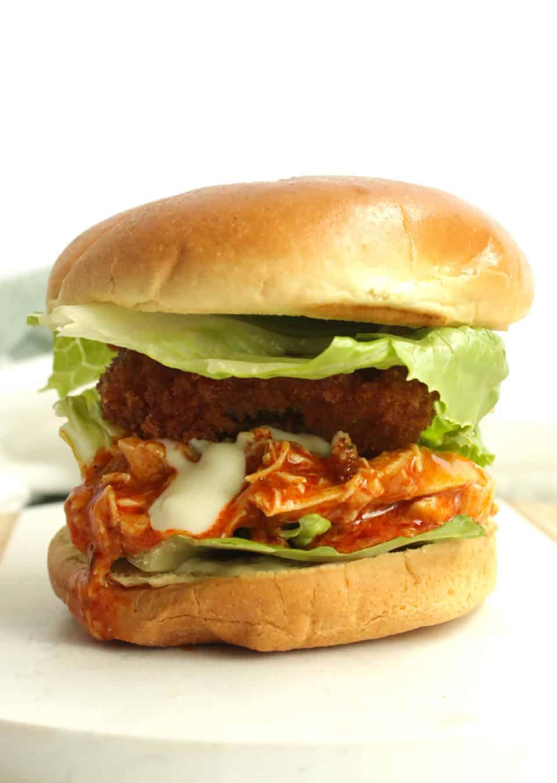 A shredded buffalo chicken sandwich ready to serve