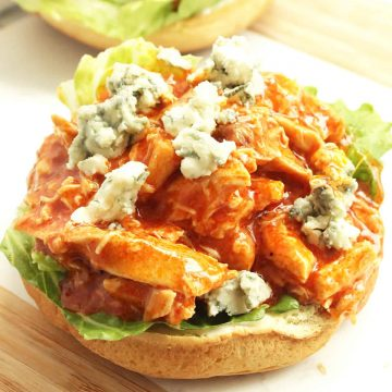Close up of the shredded chicken on the sandwich