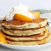 Peach pancakes topped with whipped cream