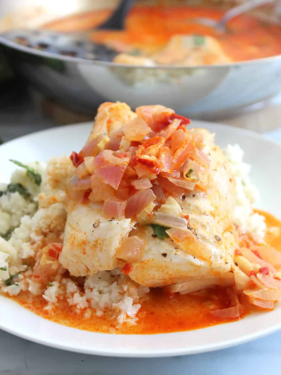 Fish served with cauliflower rice