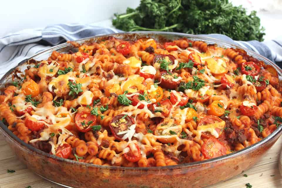 Beef pasta bake in a glass dish ready to serve.
