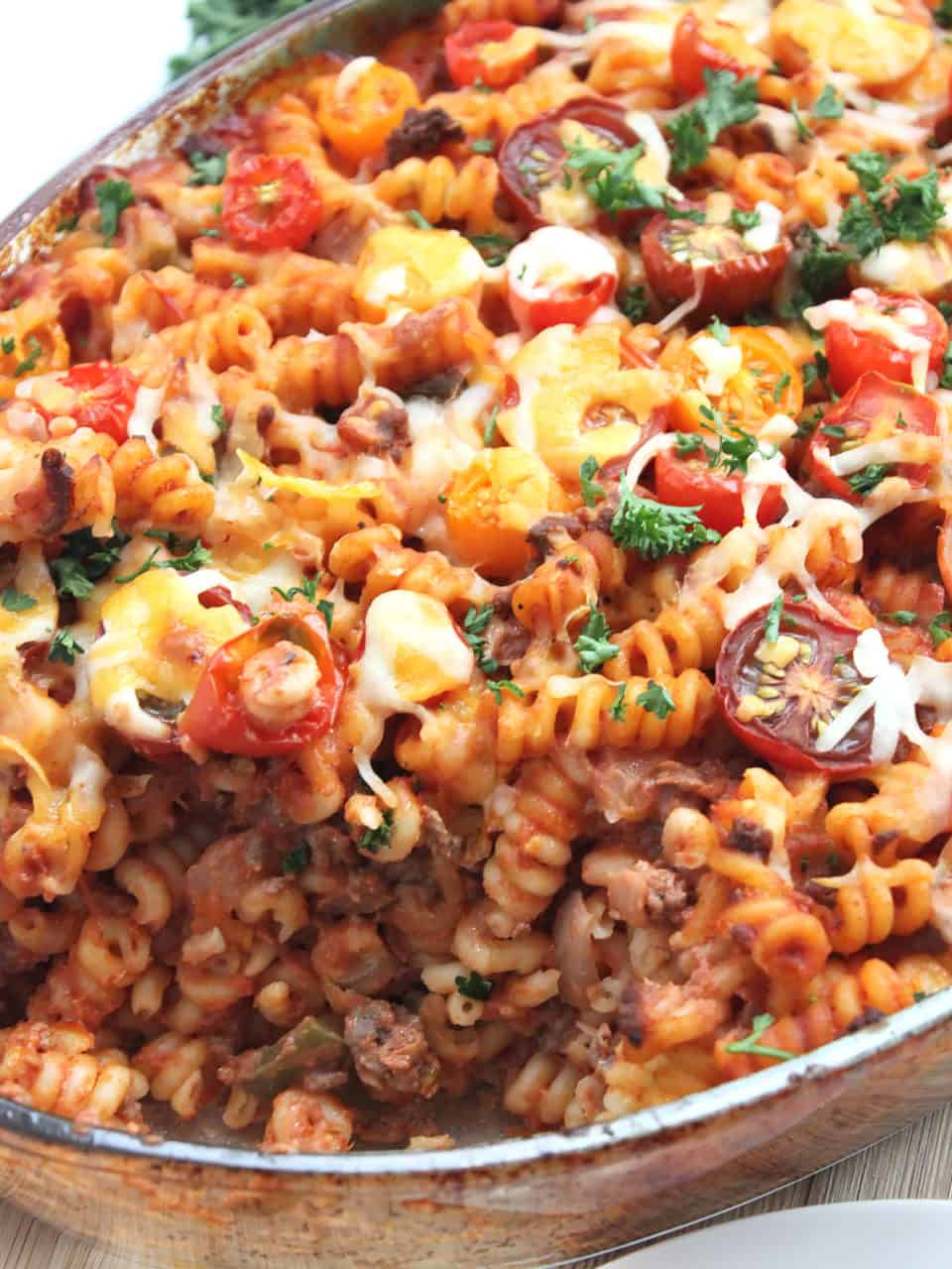 Close up of the pasta bake with a spoonful taken out of it.