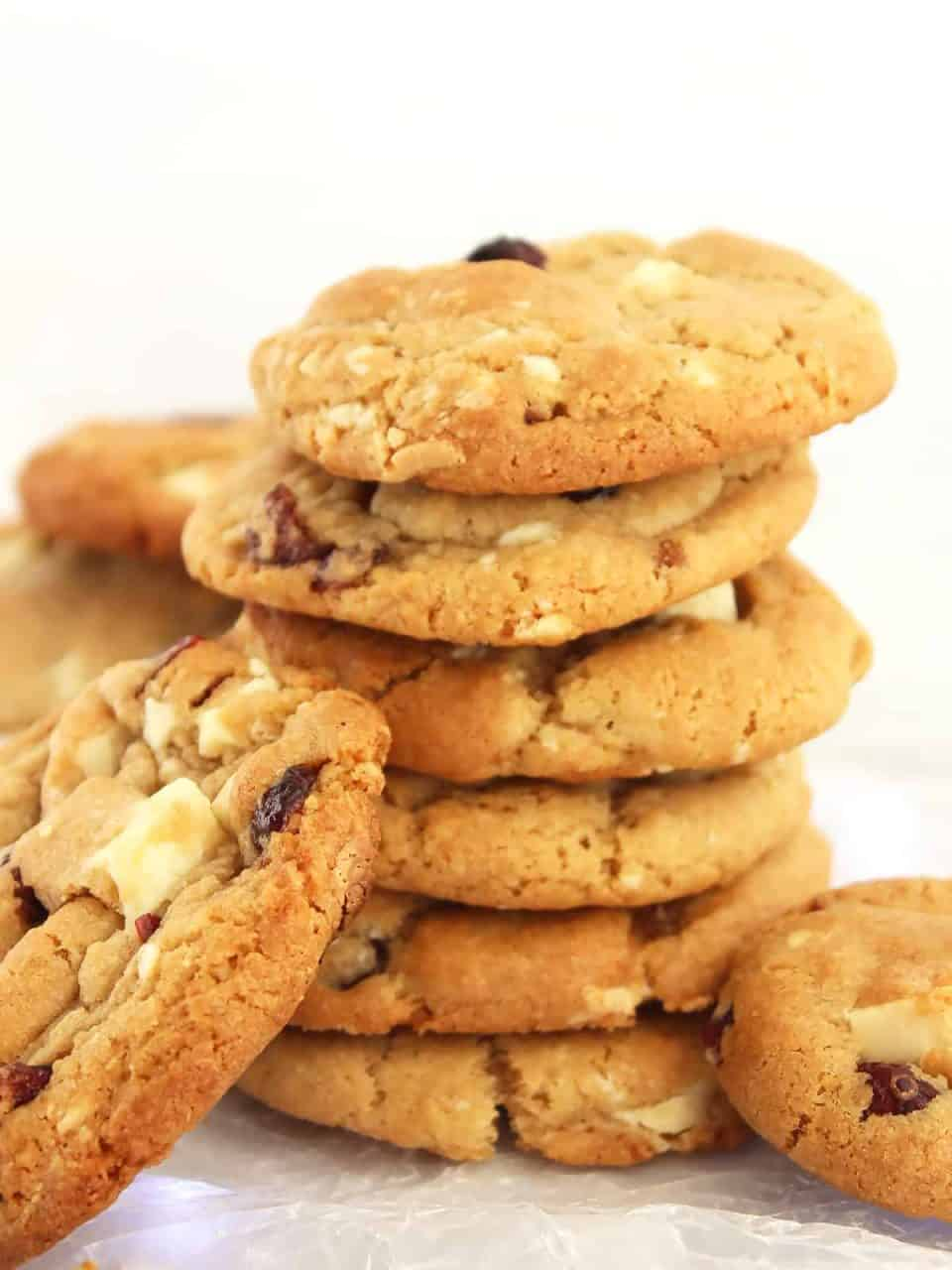 A stack of cookies with white chocolate chunks and cranberries.