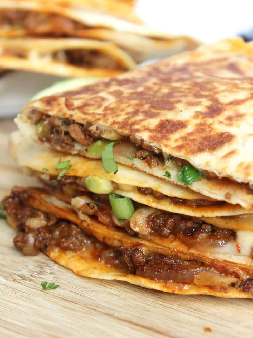 Quesadillas garnished with scaliions.