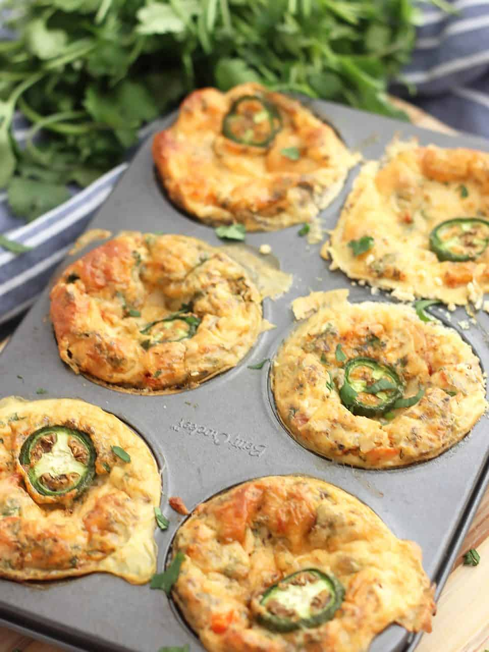 Baked egg bites in a muffin tin ready to serve.