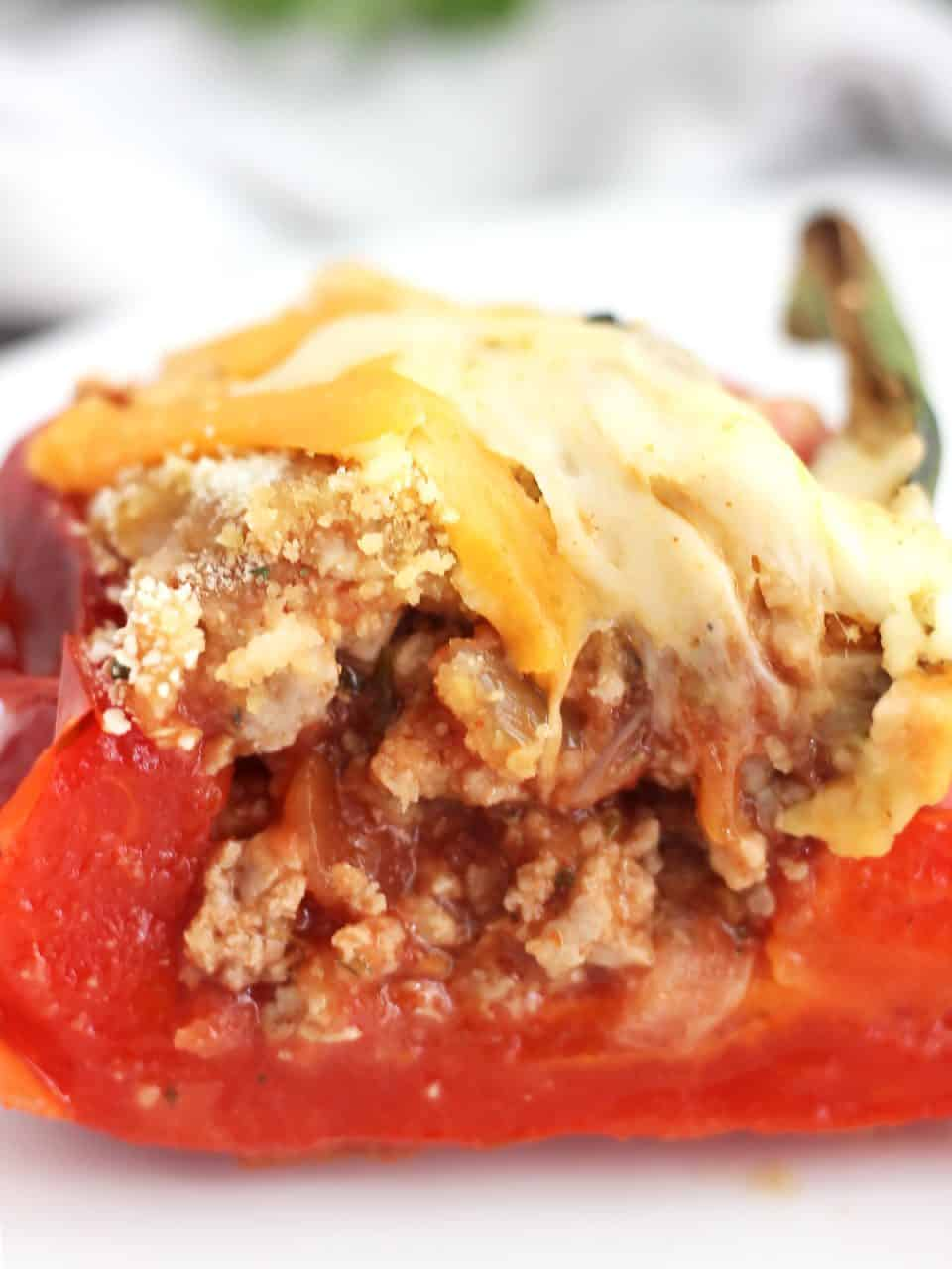 Close up of a stuffed pepper cut in half to show the filling.