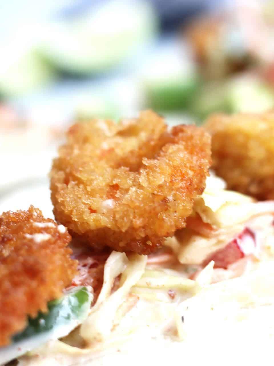 Close up of a crispy fried shrimp.