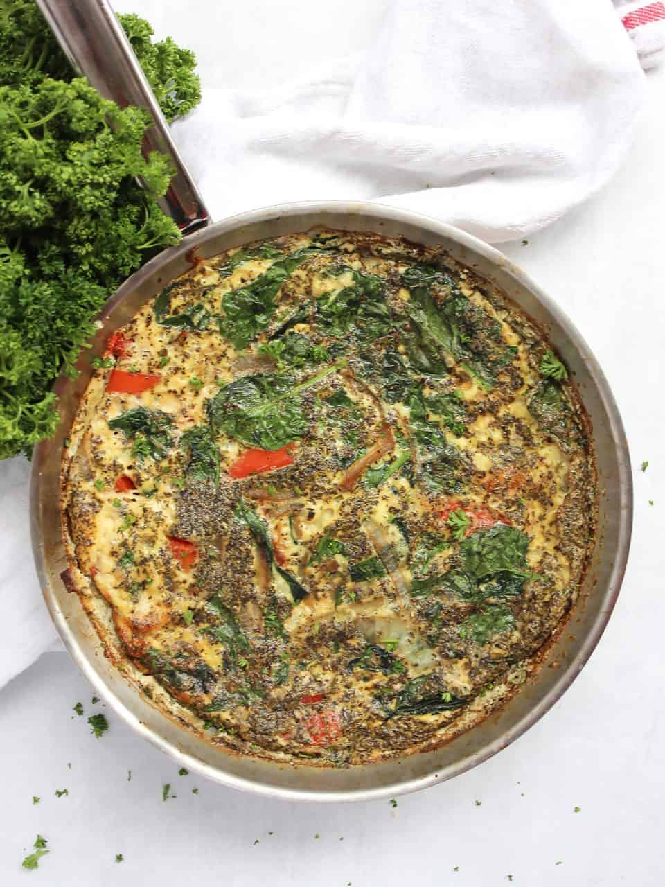 Vegetable and egg white frittata in a silver skillet.
