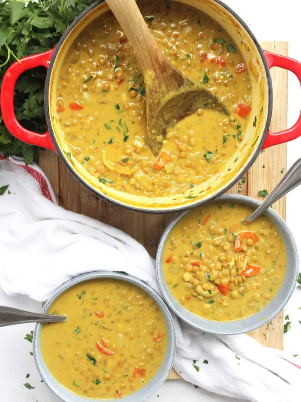 Turmeric lentil soup in a dutch oven and served into two bowls.