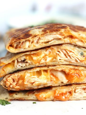 Buffalo chicken quesadillas cut in half and stacked on top of each other.