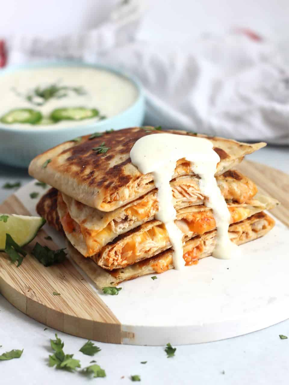 The quesadillas drizzled with a jalapeno sour cream sauce.