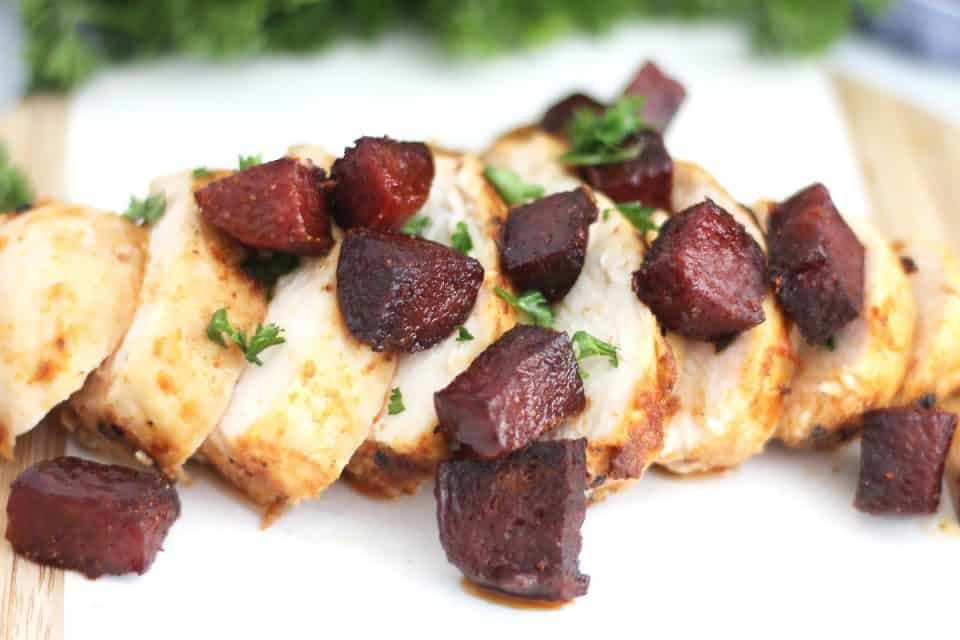 Sliced cooked chicken breast topped with cubes of chorizo.