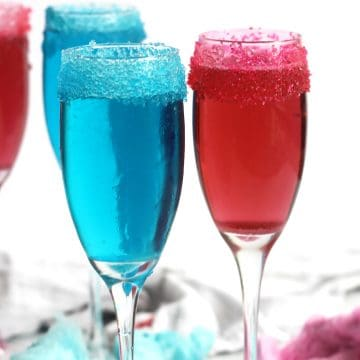 A blue and pink cotton candy champagne next to each other.