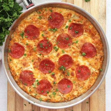 Pepperoni pizza frittata in a silver skillet.
