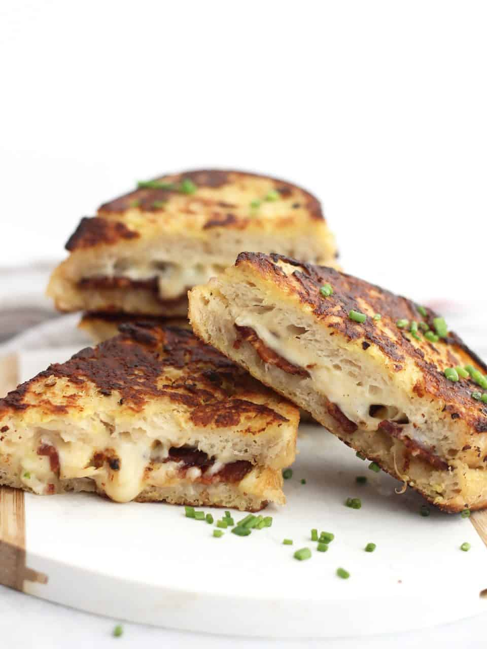 Bacon and cheese French toast cut in half and stacked on top of each other.