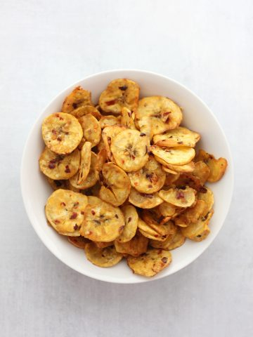 Overhead shot of a bowl full of crispy plantain chips.