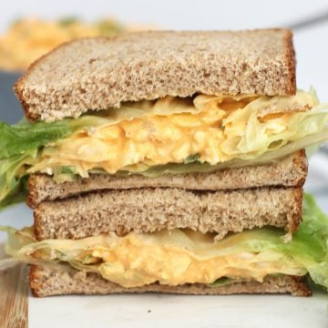 Buffalo egg salad served in a sandwich with fresh lettuce.