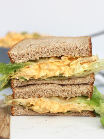 A buffalo egg sandwich with lettuce.