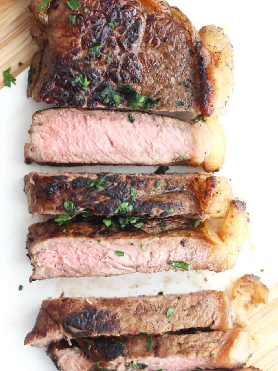 Overhead shot of a cola marinated steak sliced into strips.